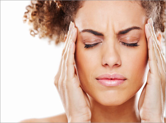 Natural Cures for Headaches_woman with headache