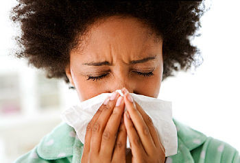 more cold and flu remedies- woman with runny nose