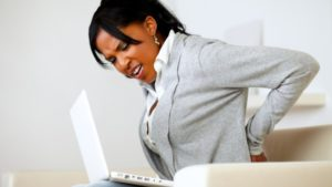 7 Tips to Improve Your Posture_woman with back pain
