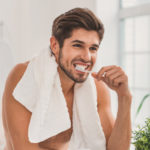 The Health Connection Between Your Mouth And Body_man brushing teeth