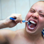 10 Everyday Habits That Ruin Your Oral Health_brushing too hard