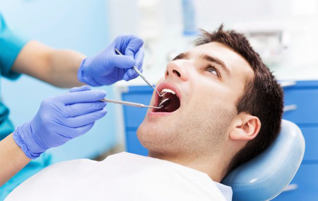 How Your Oral Health Affects Your Overall Health_man having dental exam