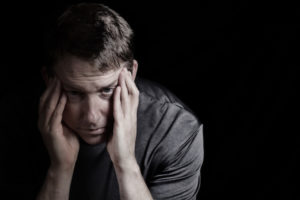 Alternative Treatment for Heroin and Opioid Addiction_mature man with headache