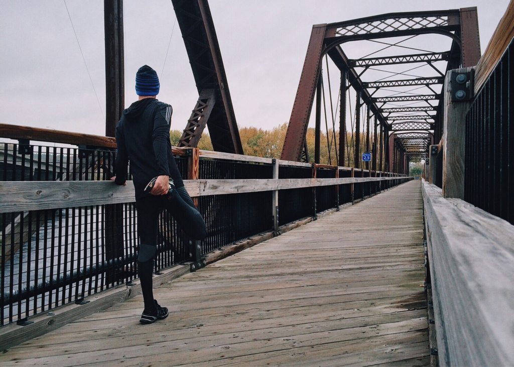 Healing-Power-How-Exercise-Helps-to-Heal-Your-Injuries-Faster_jogger stretching on bridge
