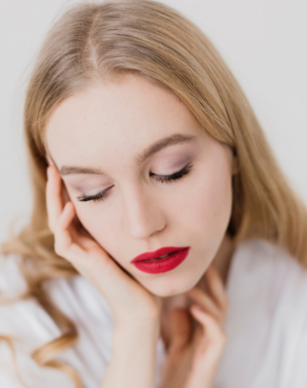 Cosmetics-and-Acne-–-You-don't-have-to-give-up-one-to-prevent-the-other_woman wearing red lipstick