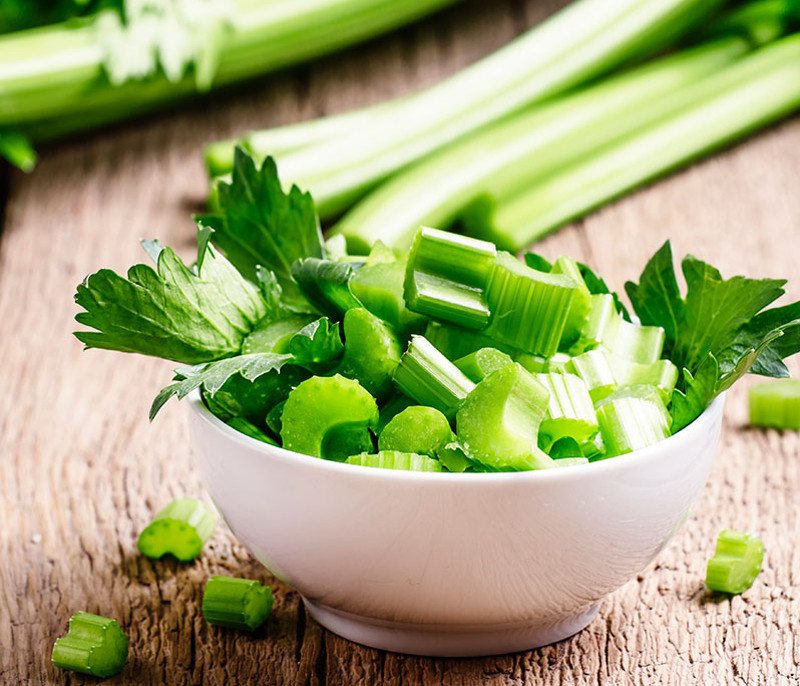 The Many Health Benefits of Eating Celery_chopped celery in bowl