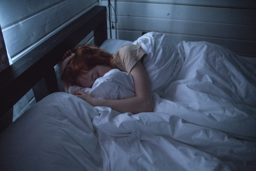 Naturally Living Longer with Sleep_woman sleeping in bed
