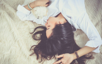 5 Relaxing Bedtime Routines for Adults_sleeping with dog